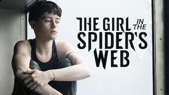 蜘蛛の巣を払う女